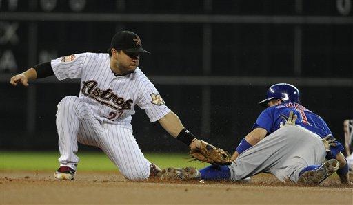 Houston's Jose Altuve tags Campana as he comes into the base. (AP/Pat Sullivan)