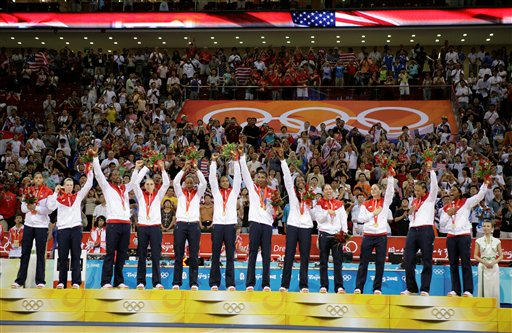 The U.S. women's basketball team grabs their fifth straight gold medal. (AP/Dusan Vranic)