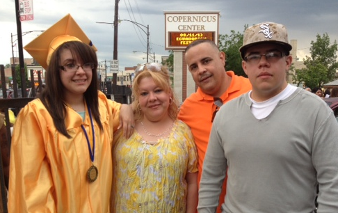 Medina, his wife Jeanette Vázquez, and their children Kelvin and Dalysha celebrate Dalysha's graduation last year from Prosser Career Academy, a high school on Chicago's Northwest Side. (Family photo)