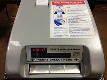 The Optech scanner is used to scan paper ballots in Chicago elections. (WBEZ/Logan Jaffe)