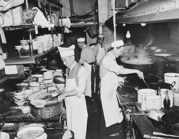 Chefs at work in the kitchen of a restaurant in New York's Chinatown, circa 1940. For many Chinese, opening up restaurants became a way to bypass U.S. immigration laws designed to keep them out of the country. (Weegee(International Center of Photography/Getty Images)