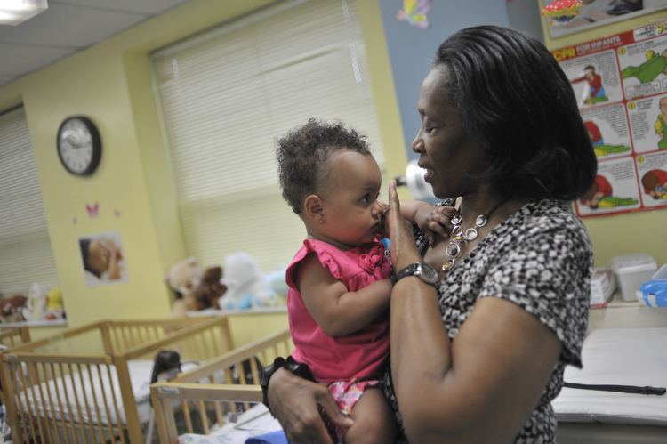 Clinical Director Florence Wright holds a child at The Women's Treatment Center. Wright oversees day-to-day operations of the center's daycare, crisis nursery and preschool classroom among other things. (WBEZ/Bill Healy)