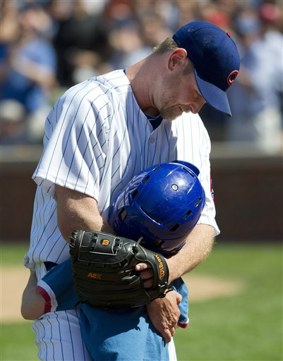 Kerry Wood is greeted by his son, Justin, after striking out his final batter on Saturday. (AP/Jim Prisching)