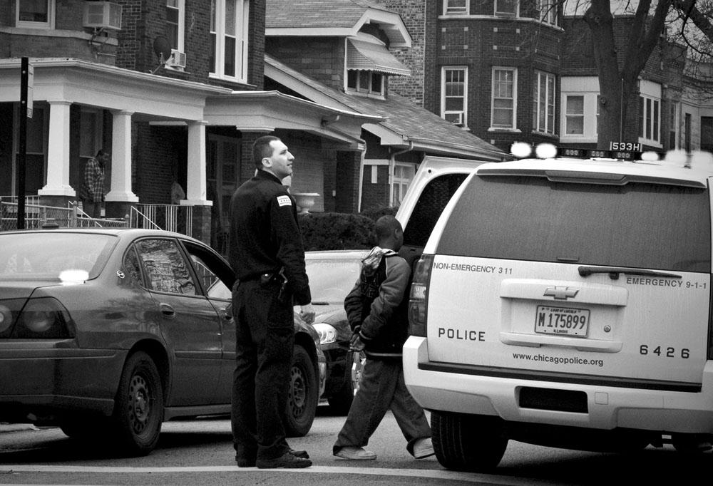 File: Chicago police officer arresting a juvenile. (Carlos Javier Ortiz/WBEZ)