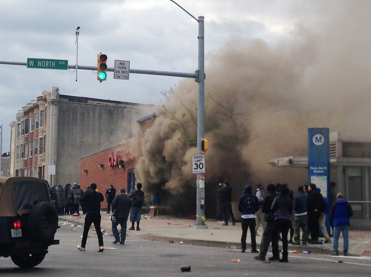 Smoke billows from a CVS Pharmacy store in Baltimore on April 27. Demonstrators clashed with police after the funeral of Freddie Gray, who died from spinal injuries about a week after he was arrested and transported in a Baltimore Police Department van. (Juliet Linderman/AP)