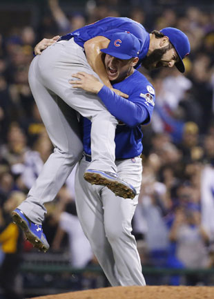 Chicago Cubs first baseman Anthony Rizzo hoists starting pitcher Jake Arrieta aloft after he finished a complete-game shutout of the Pittsburgh Pirates in the National League wild card game Wednesday in Pittsburgh. Arrieta struck out 11 while giving up four hits and no walks. (Gene J. Puskar/AP)