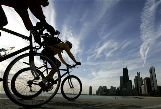 WBEZ, the Old Town School of Folk Music and the Center for Neighborhood Technology are three of the organizations participating in the annual Chicago Bike Commuter Challenge. (AP Photo/Charles Rex Arbogast)