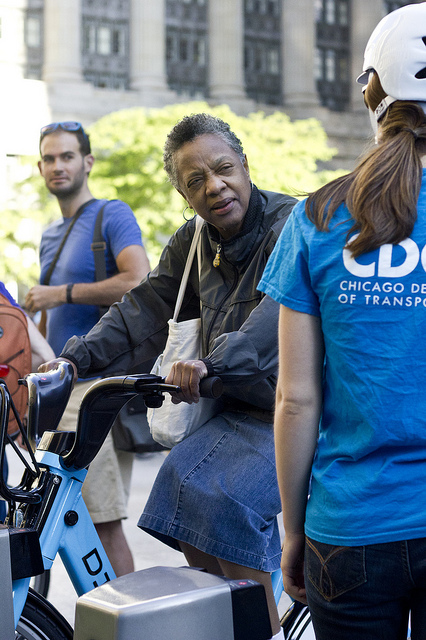 A prospective Divvy member tries out one of the new bikes. Some black Chicagoans want more more stations on the South and West sides. (WBEZ/Robin Amer)