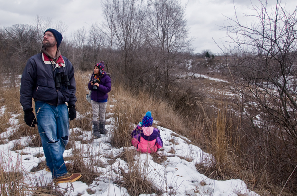 Dave Poweleit, first-time birder Alejandra, and Poweleit's daughter Molly count birds in Kane County as part of a global citizen science initiative. (WBEZ/Chris Bentley)