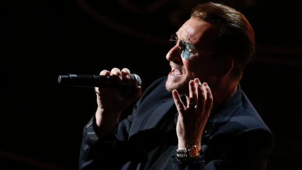 Bono, he just thinks he's God. (bono (Lucy Nicholson, Reuters via Q))