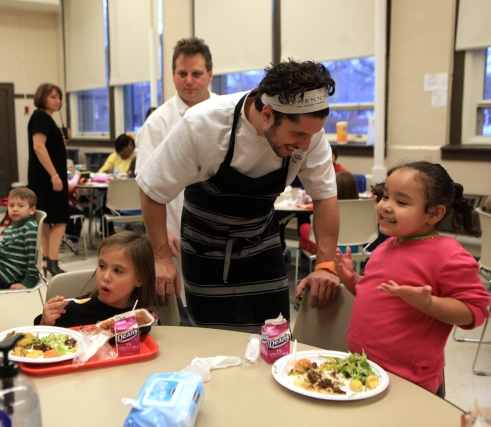 At one of the first Pilot Light tastings in Disney II Elementary School chefs Paul Kahan and Ryan Poli talk to kids about the tastings they brought for the day. (WBEZ/Monica Eng)
