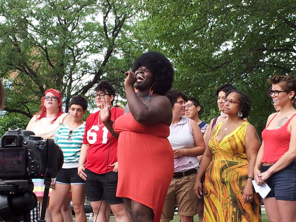 (Source: Brynn Cassie West) Photo of KOKUMO singing with Chicago's Queer Choir