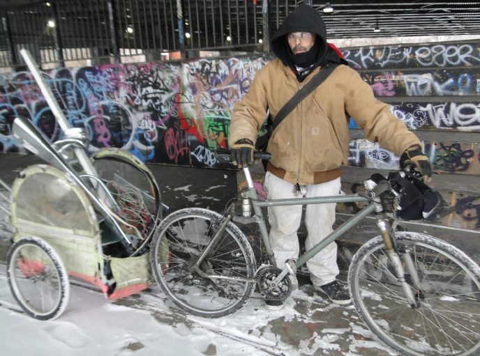 Ulysses Bonilla travels by bike to look for scrap metal even on the coldest winter days. (WBEZ/Linda Paul)