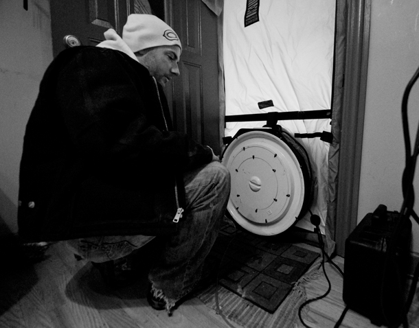 A contractor with Building Energy Experts conducts a blower door test to assess an Avondale home's leakiness. (WBEZ/Chris Bentley)