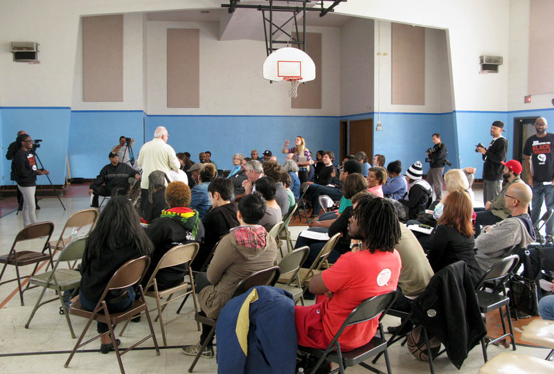 Activists gather at a school next door to the Greater St. Mark Family Church in Ferguson, Mo. for a meeting of what the Organization for Black Struggle was calling a 'People's Movement Assembly.' (Cheryl Corley/NPR)