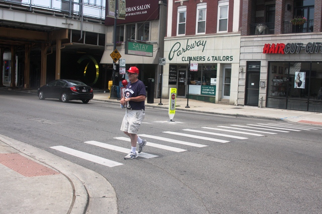 Any intersection is considered a crosswalk. It does not need to have painted white lines. (WBEZ/Logan Jaffe)