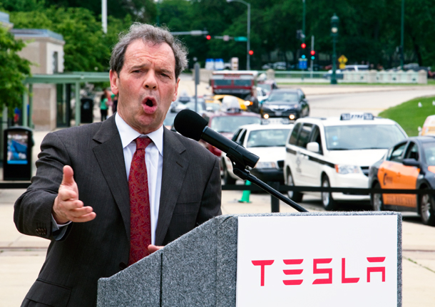 Illinois Senate President John Cullerton, who owns a Tesla Model S, touts the California company's new Normal, Ill. Supercharging station at a press conference in front of the Museum of Science & Industry. (WBEZ/Chris Bentley)