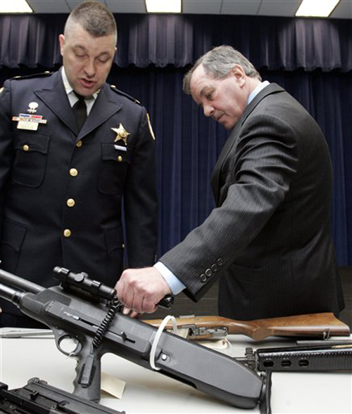 In this 2006 Associated Press photo, Chicago Mayor Richard M. Daley, right, examines assault weapons at a news conference in Chicago. The original caption reads: 'Daley is one of the country's most vocal supporters of gun control. While many Chicago suburbs and neighboring communities are rushing to repeal their gun bans following the June 2008 U.S. Supreme Court decision that affirmed the right to keep guns for self-defense in the home, Chicago is standing firm despite the court's decision. Chicago, San Francisco and Washington are all being sued over their bans.' (Source: Charles Rex Arbogast/AP)