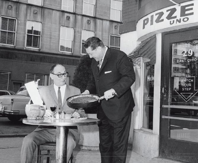 Lou Malnati eating at Chicago's original deep dish pizza place, Pizze Uno, which later changed to Pizzeria Uno, at 29 East Ohio St.