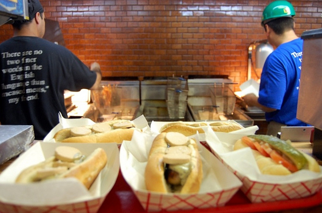Foie gras and Chicago-style hot dogs with line cooks at Hot Doug's (WBEZ/Louisa Chu)