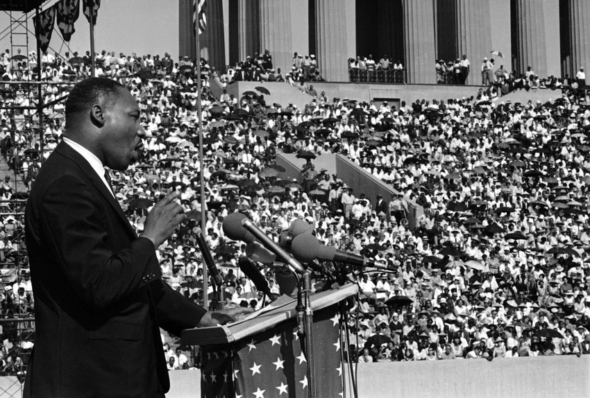 Dr. Martin Luther King addresses a crowd estimated at 70,000 at a civil rights rally in Chicago's Soldier Field in 1964. (AP/Charles E. Knoblock)