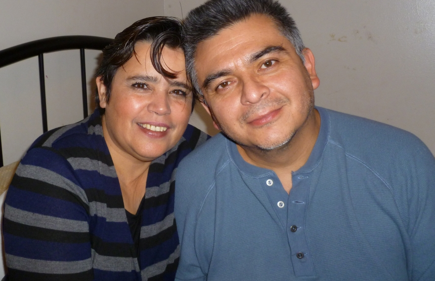 Carlos Centeno, photographed with his partner Velia Carbot, was a temp worker at a Chicago-area factory in 2011 when scalding-hot acid erupted from a tank, burning most of his body. His bosses refused to call 911, and more than 98 minutes passed before he arrived at a burn unit. He died three weeks later. (Centeno family)
