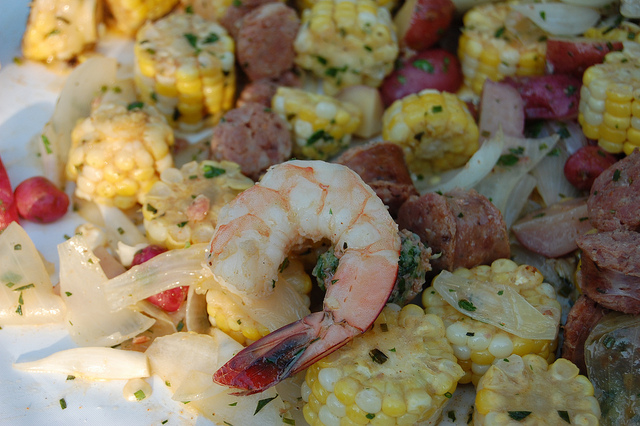 Lowcountry boil with sweet corn, potato, andouille sausage, shrimp, and hot sauces by Carriage House chefs Mark Steuer and Sean Spradlin with Nichols Farm & Orchard, Green Acres, and Gunthorp Farms (WBEZ/Louisa Chu)