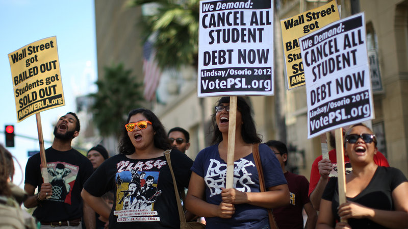Students protest the rising costs of college loans in Los Angeles in 2012. Citing bank bailouts, the protesters called for student debt cancellations. (David McNew/Getty Images)