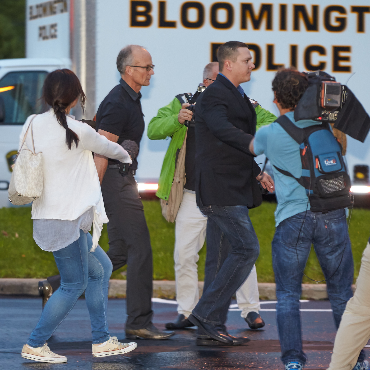 Dentist Walter Palmer, left, in short sleeves, walks into his clinic with private security and members of the media last month in Bloomington, Minn. Protests over his killing of a lion in Zimbabwe had forced him to temporarily close his practice. Now officials say they will not prosecute him. Dentist Walter Palmer (left, in short sleeves) walks into his clinic with private security and members of the media last month in Bloomington, Minn. Protests over his killing of a lion in Zimbabwe had forced him to temporarily close his practice. Now officials say they will not prosecute him.