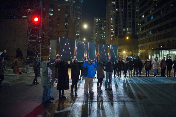 Demonstrators march through downtown Chicago on Tuesday following the release of a video showing Jason Van Dyke, a police officer, shooting and killing Laquan McDonald. Van Dyke is charged with first-degree murder for the October 2014 shooting in which McDonald was hit with 16 bullets. So far this year, 15 officers have been charged with murder or manslaughter resulting from an on-duty shooting. (Scott Olson/Getty Images)
