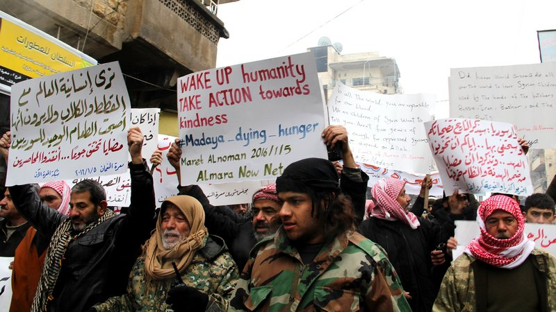 Demonstrators in Idlib, Syria, protested Tuesday on behalf of civilians starving in the besieged town of Madaya, Syria. (Anadolu Agency/Getty Images)