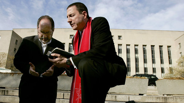 The Rev. Rob Schenck, of the National Clergy Council, right, and the Rev. Patrick Mahoney, director of the Christian Defense Coalition, pray in front of the J. Barrett Prettyman Federal Courthouse in Washington, D.C., in 2005. Schenck is a pro-life activist who believes gun ownership and the use of guns is a decision best decided by community leaders, not the government. (Mark Wilson/Getty Images)