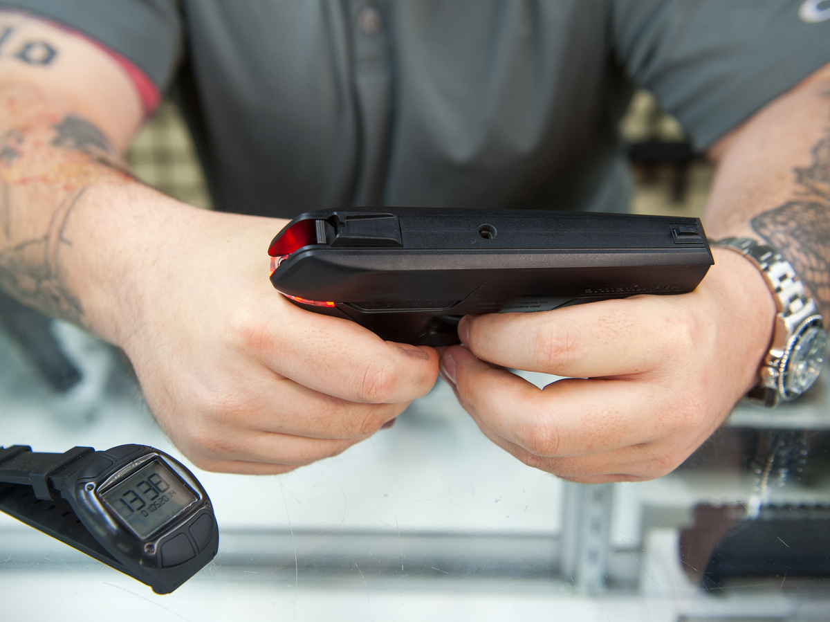 Andy Raymond demonstrates the Armatix iP1, a .22-caliber smart gun that has a safety interlock, at Engage Armaments in Rockville, Md., last year. (Katherine Frey/The Washington Post/Getty Images)