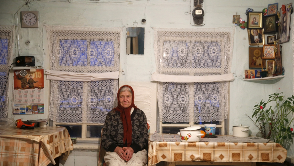 Vassa, 86, who suffers from hearing difficulties, poses in her house in the village of Kalach, Sverdlovsk region, Russia October 18, 2015. (Maxim Zmeyev/Reuters)