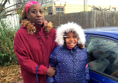 Angel Hinton with her daughter, Cameisha, 8. Hinton's business suffered after her license was suspended. (Joseph Shapiro/NPR)