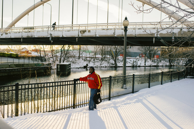 J.L. Gross walks along a river pathway near the Lathrop Homes. He has lived in the development for 27 years and cherishes Lathrop because