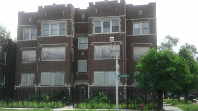 A boarded up building in Chicago Lawn. Neighborhood activists say fixing vacancies should be a priority of the home equity districts. (WBEZ/Natalie Moore)