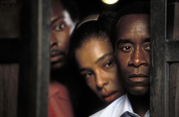 From right: Don Cheadle, Sophie Okonedo and Antonio David Lyons star as Paul, Tatiana, and Thomas in United Artists' drama 'Hotel Rwanda.' (PRNewsFoto/SHOWTIME,Bid Alsbirk)