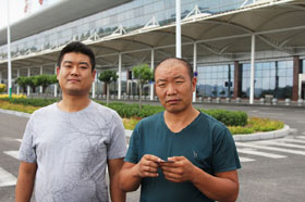 Wu Youfu (at left) and his uncle, Wu Dexi, a farmer, took Youfu's grandmother to visit Luliang's airport, a popular attraction for curious local farmers. It was conceived when this coal city was booming. Now the economy is in recession. (Frank Langfitt/NPR)