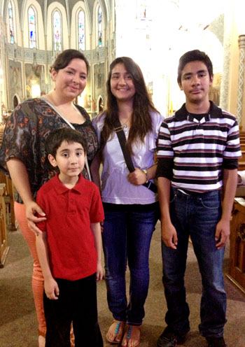 Crista, back left, attends Mass with her three American born siblings. They pray for immigration reform for their parents who are undocumented. (WBEZ/Michael Puente)