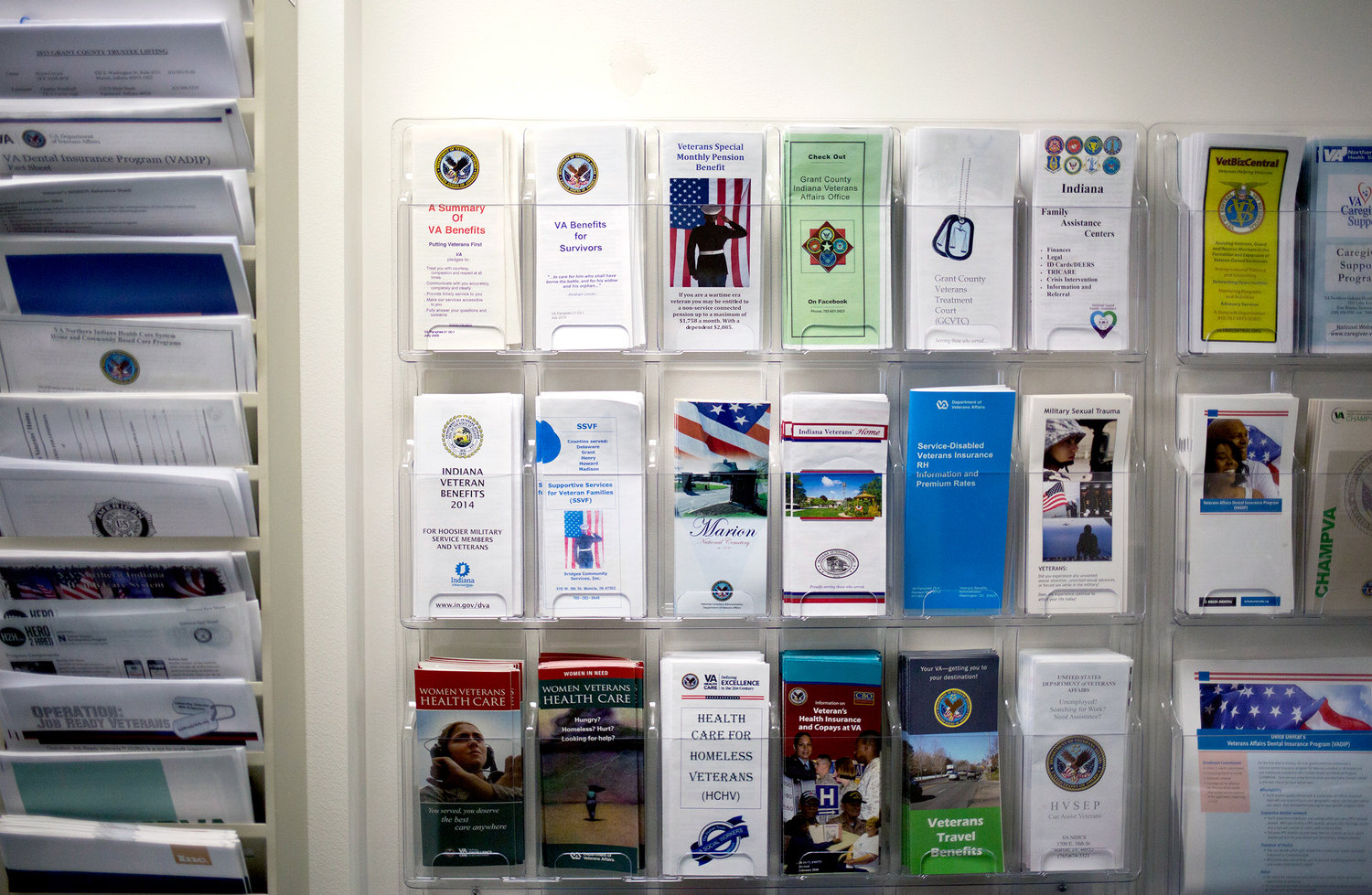 Pamphlets detailing services available to veterans are displayed in VSO Bob Kelley's office in Marion, Ind. Aaron P. Bernstein for NPR