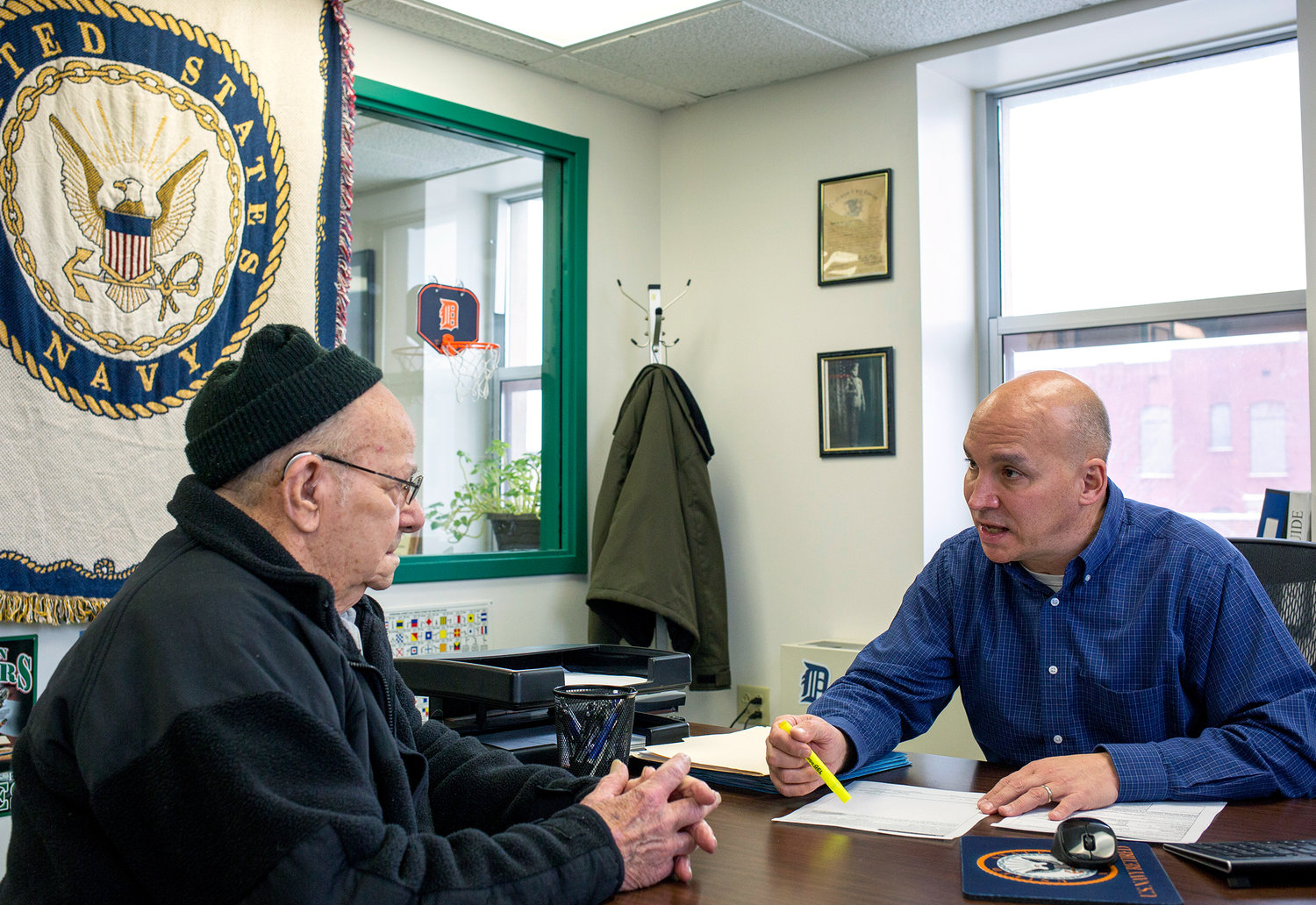 Grant County Veterans Service Officer Bob Kelley, right, works with World War II Army veteran Frederick Kern at the Grant County Government Building in Marion, Ind., on Monday. Aaron P. Bernstein for NPR