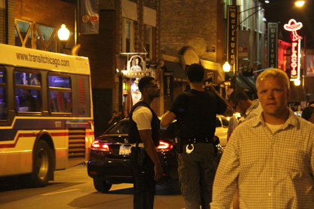Police officers patrol a busy part of Clark Street on a Saturday night. The Wrigleyville neighborhood is part of the CPD's 19th district and the area near the ball park is defined as beat 1924.