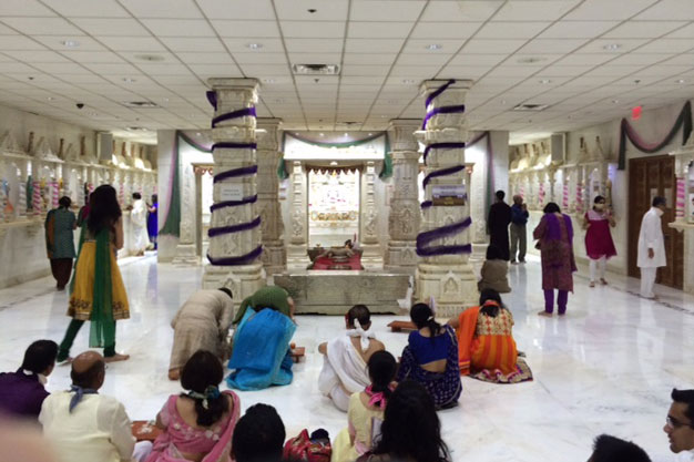 Members of the Jain community pray and read scripture in their Bartlett Temple. (WBEZ/Lynette Kalsnes)