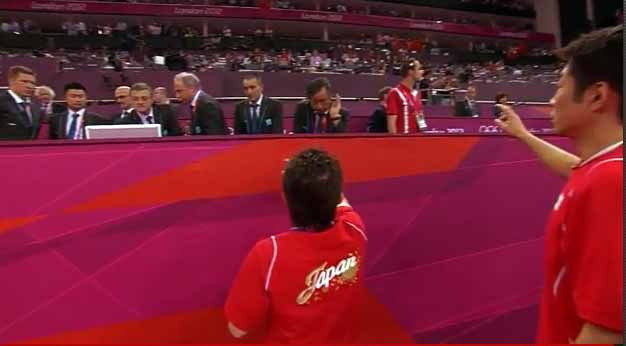 Japanese coaches argue with the judges about the score for Kohei Uchimura.