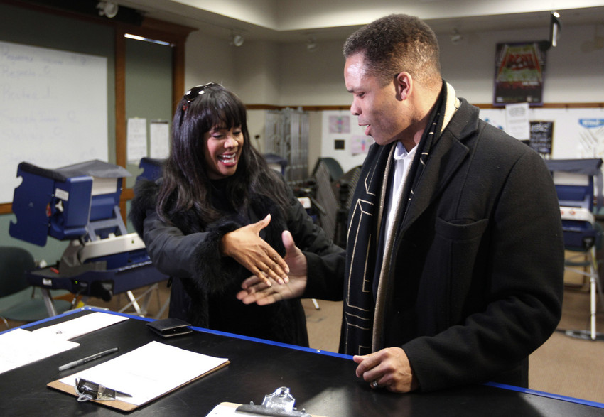U.S. Rep. Jesse Jackson Jr. and his wife, Chicago Alderman Sandi Jackson, asked each other for their support and votes as they arrived at a polling station for early voting in March of this year. (AP Photo/M. Spencer Green)