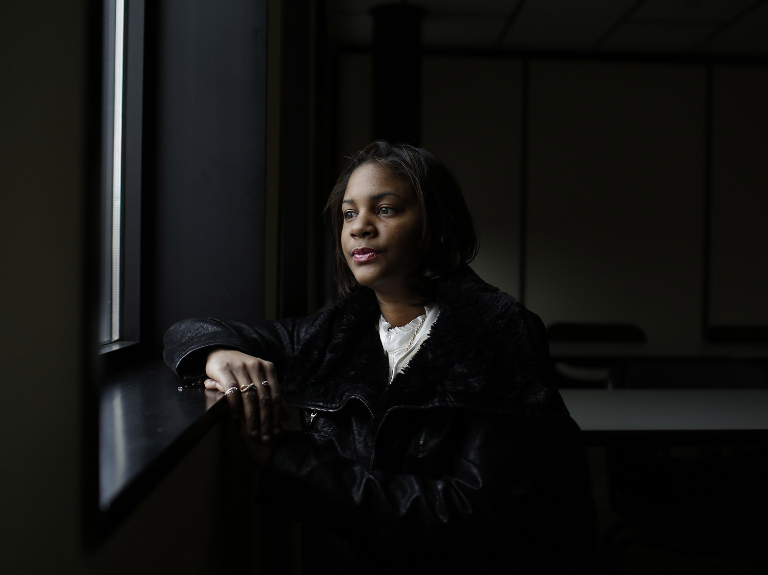 When Jasmine Uqdah aged out of the foster care system in 2008, she didn't have a job, a checking account or a car. She did have a college acceptance letter — but no money to pay for schooling. (Joshua Lott for NPR)