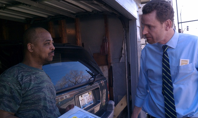 John Groene, right, pays a visit to a homeowner facing foreclosure (WBEZ/Ashley Gross)