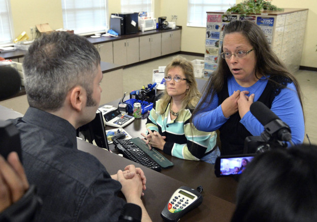 Rowan County Clerk Kim Davis, right, talks with David Moore following her office's refusal to issue marriage licenses at the Rowan County Courthouse in Morehead, Ky., Tuesday, Sept. 1, 2015. Although her appeal to the U.S. Supreme Court was denied, Davis still refuses to issue marriage licenses. (Timothy D. Easley/AP)