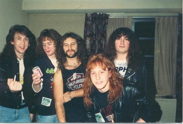 Jason Leopold is on the far left, holding the cigarette. It's at a hotel in NYC right before a concert for the band Overkill at The Ritz. The guy with the beard is Bobby Gustafson, guitarist for Overkill.